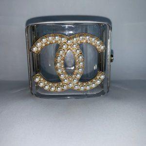 Chanel CC logo transparent Pearl hinged cuff